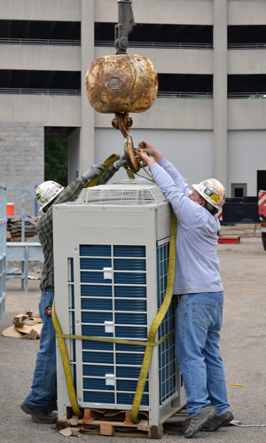 Mason & Barry technicians prepare HVAC equipment for installation.
