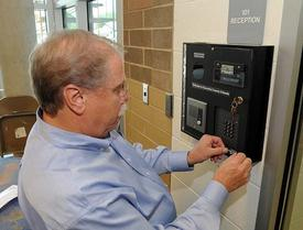 Mason & Barry's Clacy Williams works on an access panel at the West Virginia's first fully integrated school.